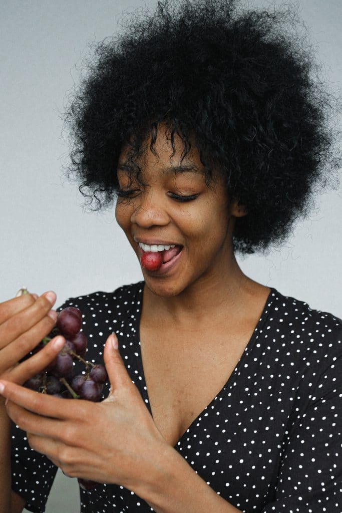 person eating grapes